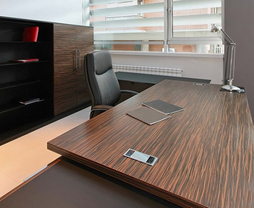 Large desk in empty modern office interior